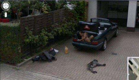 450695_naked-man-climbing-out-of-a-trunk_f